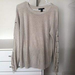 Beige sweater with tie detail along sleeves